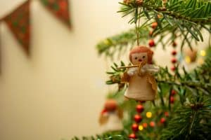Photograph of an angel decoration hanging on a christmas tree