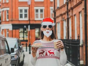 Person in a christmas costume holding a tea and coffee